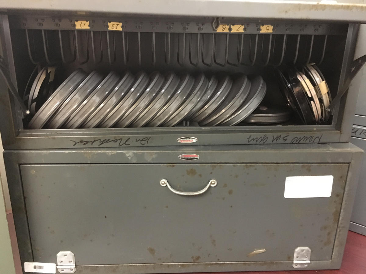 Some of the 16mm films inside one of the metal containers.
