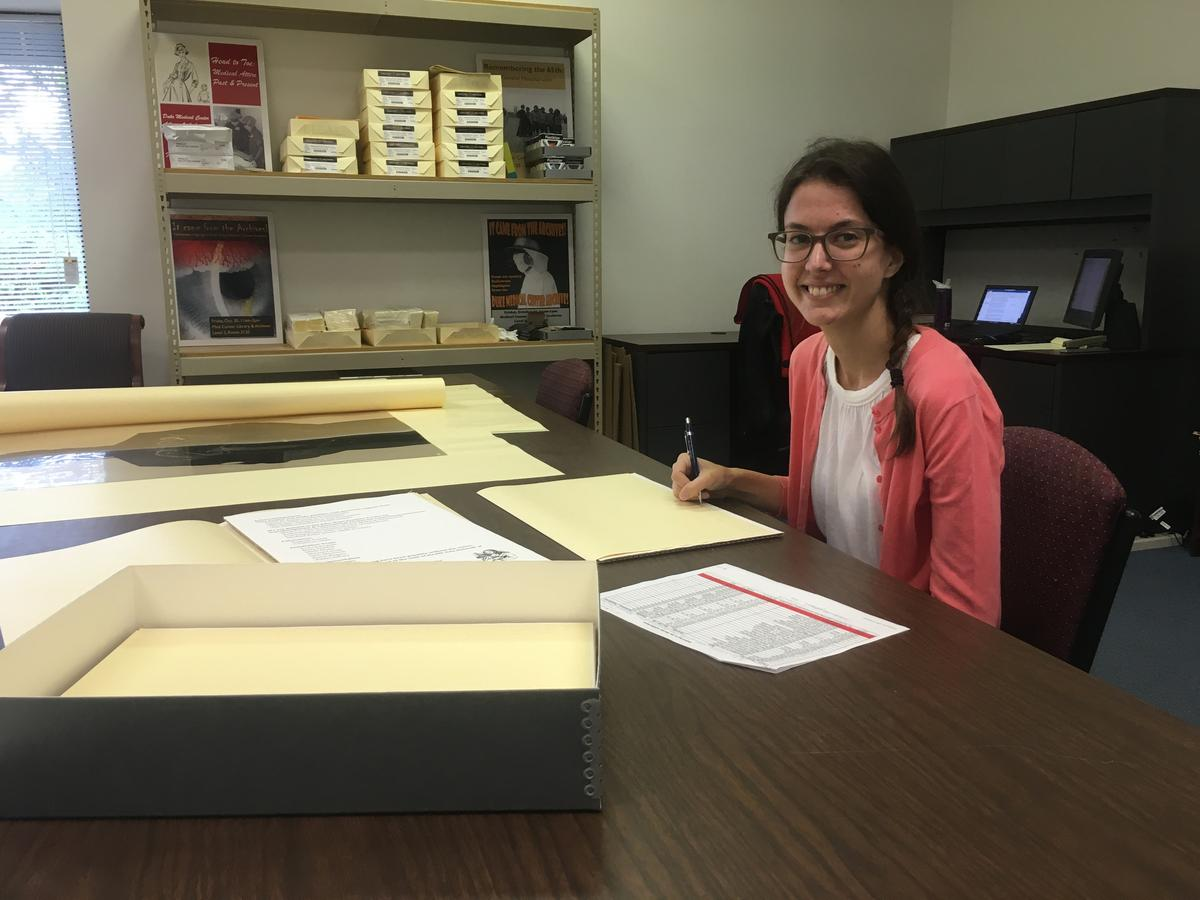 Archives intern Kahlee processing the addition