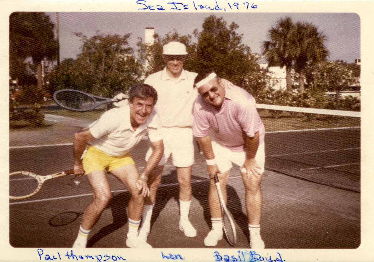 Goldner (center) poses on the tennis court in Sea Island, Georgia, with Paul Thompson (left) and Basil Boyd (right)