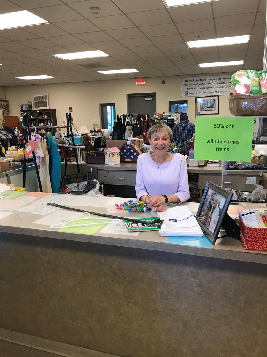 current Chair Virginia Brown Lang at the checkout counter
